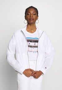 Champion Reverse Weave - FULL ZIP TOP - Summer jacket - white - 0