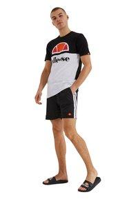 Ellesse - GENOA  - Swimming shorts - schwarz - 1