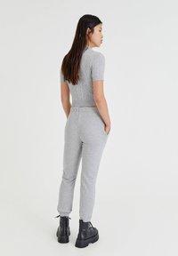 PULL&BEAR - Tracksuit bottoms - light grey - 6