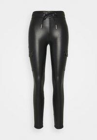 ONLZABO STRING - Leggings - Trousers - black