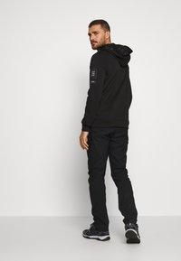 Peak Performance - ICONIQ CARGO PANT - Pantalons outdoor - black - 2