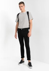 Calvin Klein Jeans - 016 SKINNY - Jeans Skinny Fit - stay black - 1
