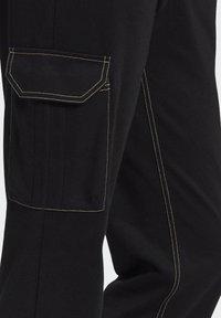 adidas Originals - PANTS - Cargo trousers - black - 7