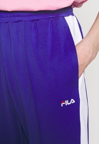 Fila - ALKAS TRACK PANT - Trousers - clematis blue/bright white - 4