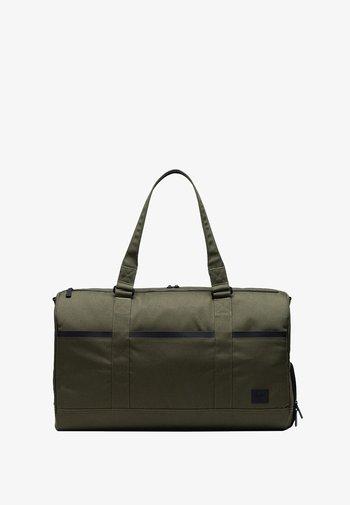 TECH NOVEL - Weekend bag - ivy green