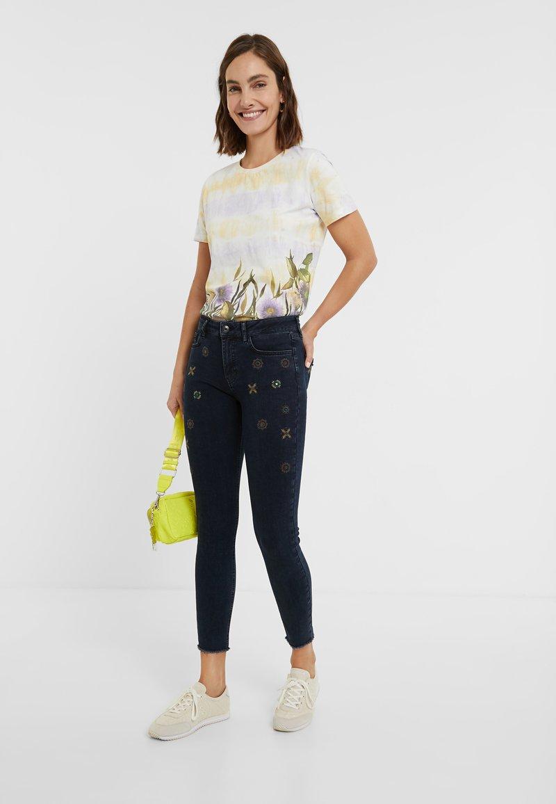 Desigual - JULIETA - Jeans slim fit - denim blue black
