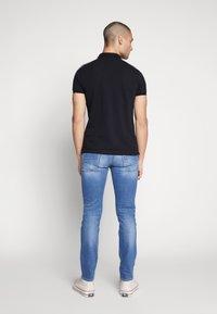 Diesel - THOMMER-X - Slim fit jeans - blue denim - 2