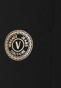 Versace Jeans Couture - PANTS - Tracksuit bottoms - black - 5