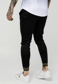 SIKSILK - AGILITY TRACK PANTS - Tracksuit bottoms - black - 2