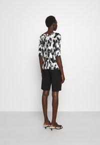 Marc Cain - Print T-shirt - black/white - 2