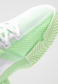 adidas Performance - SOLEMATCH BOUNCE - Zapatillas de tenis para todas las superficies - footwear white/glow green - 5