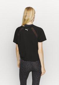 Puma - PAMELA REIF X PUMA BOXY TEE - T-Shirt print - black - 2