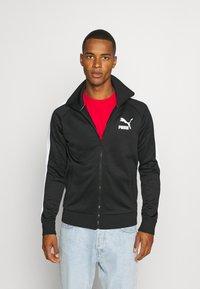 Puma - ICONIC  - Training jacket - black - 0
