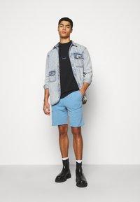 Han Kjøbenhavn - Shorts - faded blue - 1