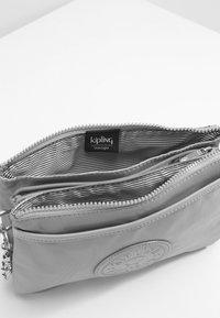 Kipling - RIRI - Across body bag - natural grey - 4
