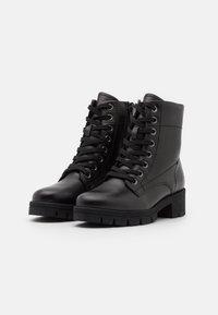 Jana - Platform ankle boots - black - 2