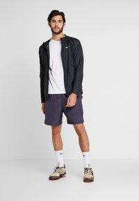 Nike Performance - Training jacket - black/reflective silver - 1