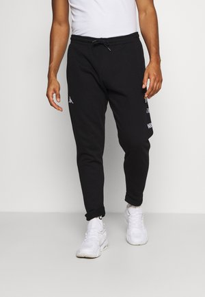 ILAY - Tracksuit bottoms - caviar