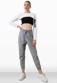 Trendyol - Tracksuit bottoms - grey - 1