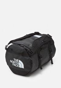 The North Face - BASE CAMP DUFFEL XS UNISEX - Hiking rucksack - black/white - 3