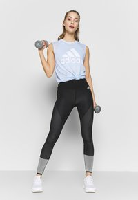 adidas Performance - MUST HAVES SPORT REGULAR FIT TANK TOP - Sports shirt - sky tint/white - 1