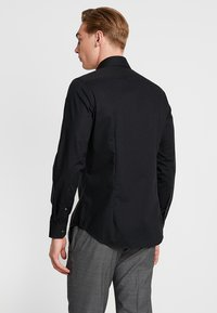 Seidensticker - SLIM SPREAD KENT PATCH - Formal shirt - black - 2