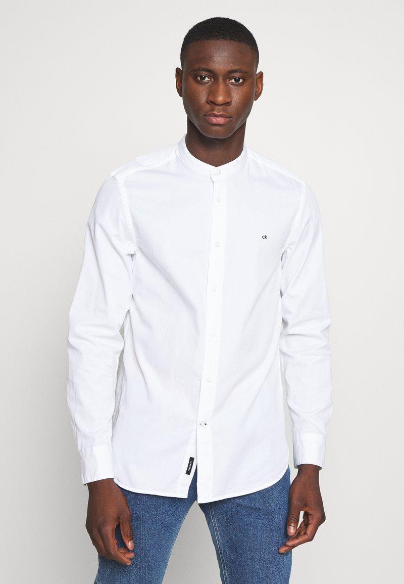 Calvin Klein - STAND COLLAR LIQUID TOUCH - Shirt - white