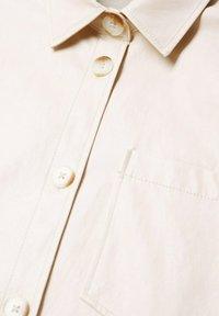 Mango - TRAVELER - Faux leather jacket - écru - 7