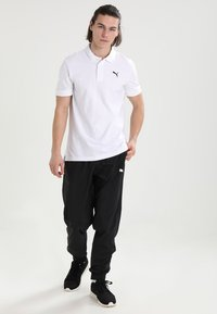 Puma - Tracksuit bottoms - black - 1