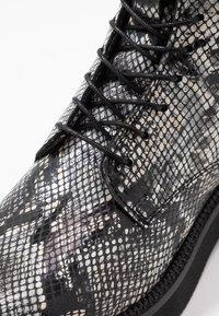 MJUS - Kotníkové boty na platformě - nero - 2
