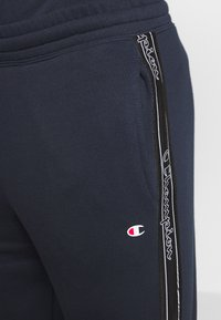 Champion - LEGACY  - Tracksuit bottoms - dark blue - 4