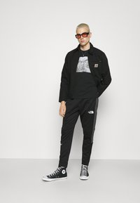 The North Face - CUFFED PANT - Träningsbyxor - black - 1