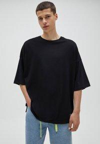 PULL&BEAR - LOOSE - T-Shirt basic - black - 3