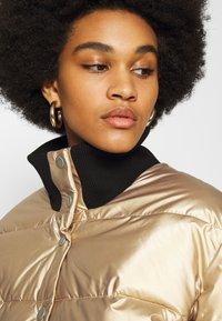Roxy - CROSS STEPPING - Winter jacket - gold - 3
