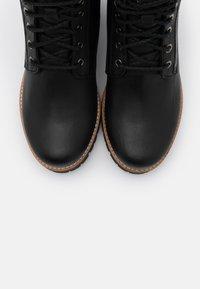Panama Jack - PHOEBE - Lace-up ankle boots - black - 5