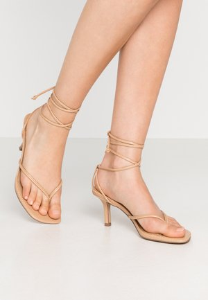 LORI - T-bar sandals - tan lizard