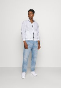 Calvin Klein - TRANSPARENT RIPSTOP LOGO BLOUSON - Summer jacket - white - 1