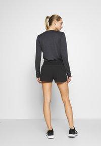 Salomon - SENSE SHORT - Sports shorts - black - 2