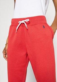 Polo Ralph Lauren - SEASONAL - Tracksuit bottoms - spring red - 5
