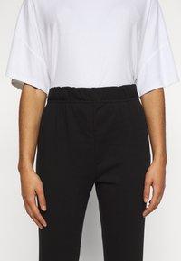 Vero Moda Petite - VMELLA BASIC PANT - Trousers - black - 5