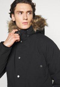 Carhartt WIP - TRAPPER  - Winter coat - black - 4