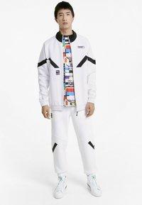 Puma - INTERNATIONAL  - Training jacket - puma white - 1