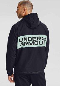 Under Armour - Veste polaire - black - 2