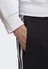 adidas Originals - BIG TREFOIL ABSTRACT POLYESTER TRACKSUIT BOTTOM - Tracksuit bottoms - black - 4