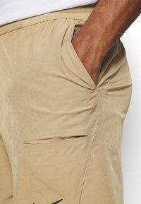 Nike Performance - Sports shorts - parachute beige/black - 3