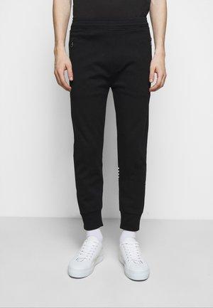 STRIPED KNITTED LEG BONDE - Teplákové kalhoty - black