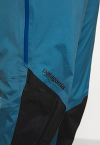 Patagonia - DIRT ROAMER STORM PANTS - Outdoorové kalhoty - steller blue - 7