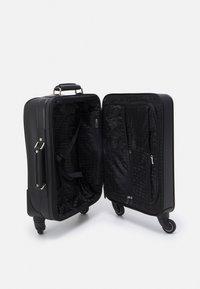 KARL LAGERFELD - IKONIK - Wheeled suitcase - black - 2
