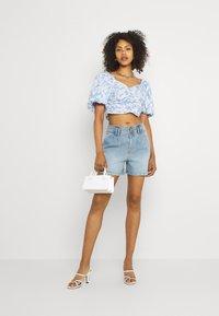 JDY - JDYCARMEN LIFE POCKET - Denim shorts - light blue denim - 1