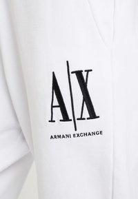 Armani Exchange - PANTALONI - Tracksuit bottoms - white - 5